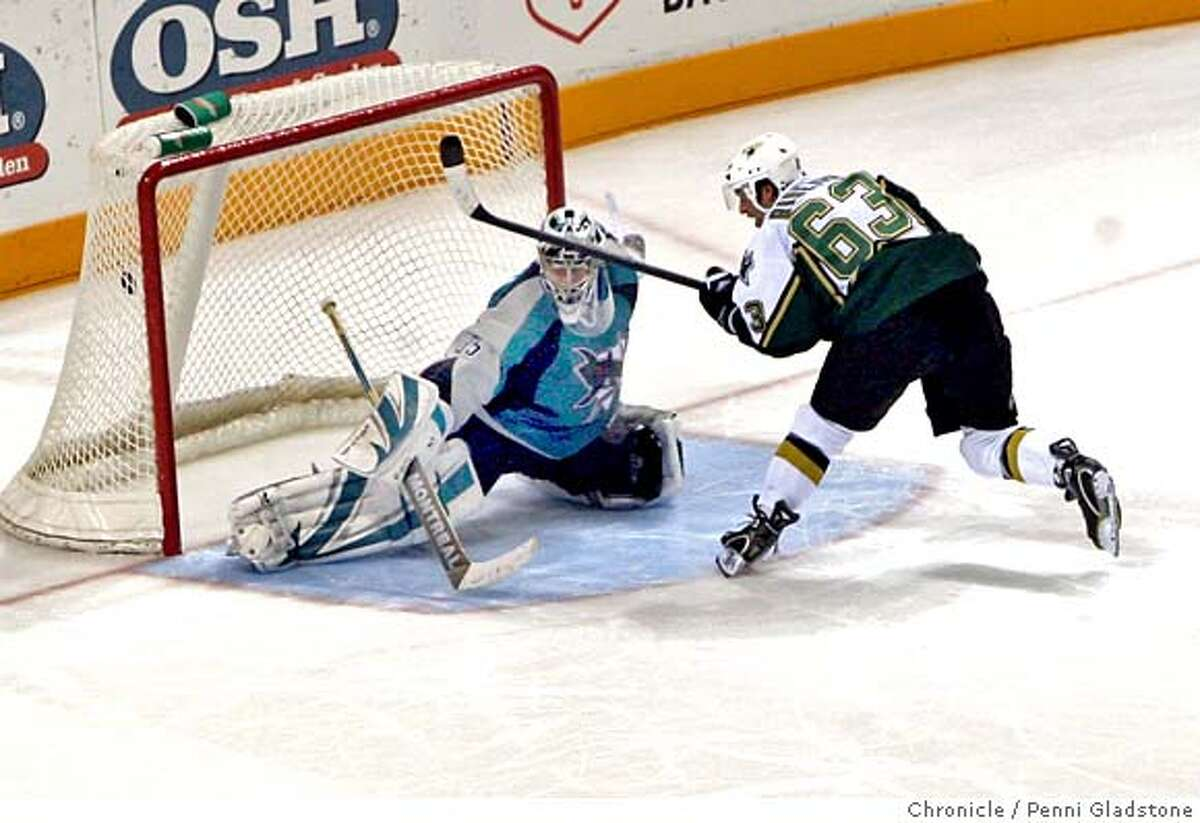 San Jose Sharks vs Dallas Stars With the puck in the goal net, the Stars win the game in the shootout as Stars, Mike Ribeiro made the goal .Sharks goalie is Vesa Toskala Event on 1/30/07 in San Jose. Penni Gladstone / The Chronicle