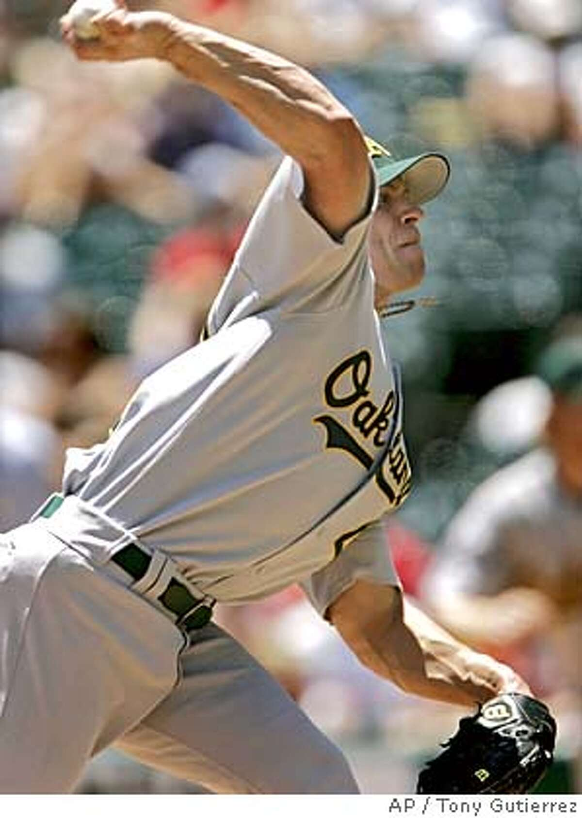 Oakland Athletics' Rich Harden delivers to the Texas Rangers in the first inning, Sunday, July 24, 2005, in Arlington, Texas. (AP Photo/Tony Gutierrez)