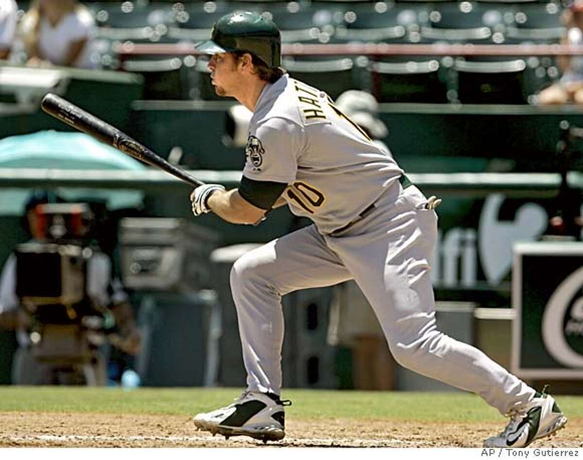 Oakland Athletics' Scott Hatteberg follows through on a single to right off of Texas Rangers' Chan Ho Park that scored Mark Kotsay in the third inning, Sunday, July 24, 2005, in Arlington, Texas. (AP Photo/Tony Gutierrez)