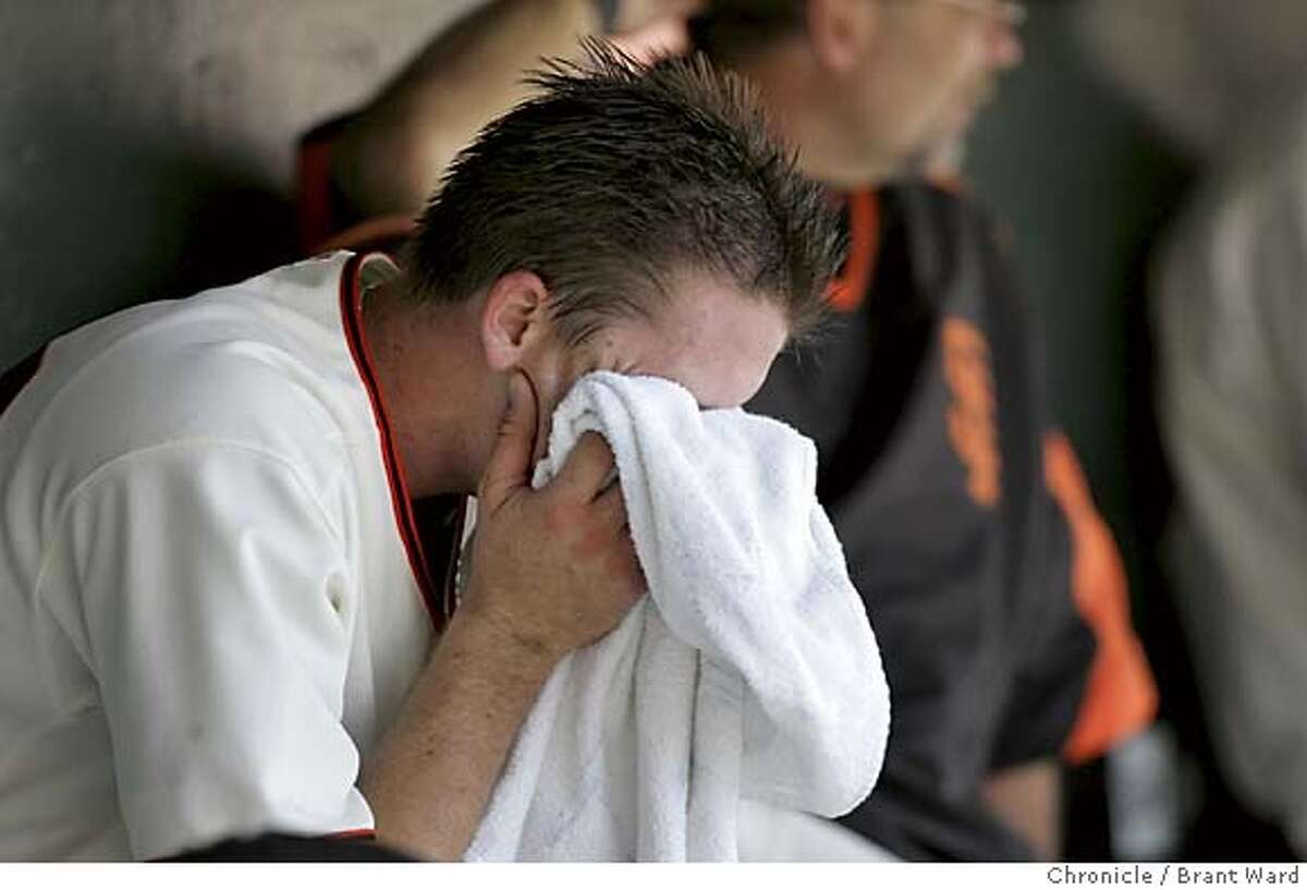 Giants starting pitcher Kevin Correia buries his head in a towel after giving up a two run home run to Juan Encarnacion in the 6th inning...the last runs of the ballgame. The Giants finished their home stand with a loss against the Marlin's 4-1 at SBC Park.Brant Ward 7/25/05