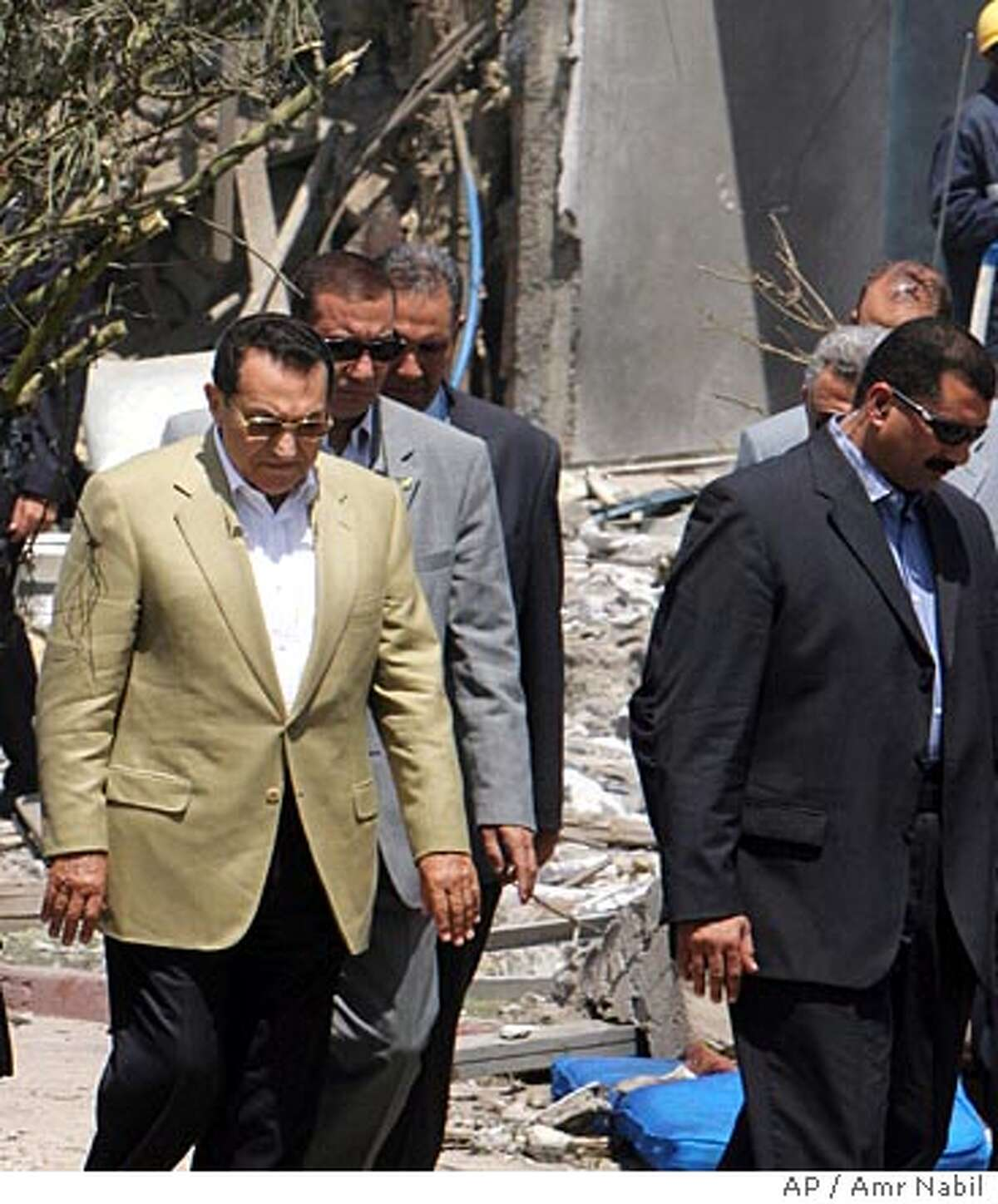 Egyptian President Hosni Mubarak, left, visits the site of a Gazala Gardens Hotel following an explosion in Egypt's Red Sea resort of Sharm el-Sheik early Saturday July 23, 2005. Mutliple explosions rocked the Egyptian tourist resort of Sharm el-Sheik in the Sinai Peninsula early Saturday targeting several hotels. (AP Photo/Amr Nabil)
