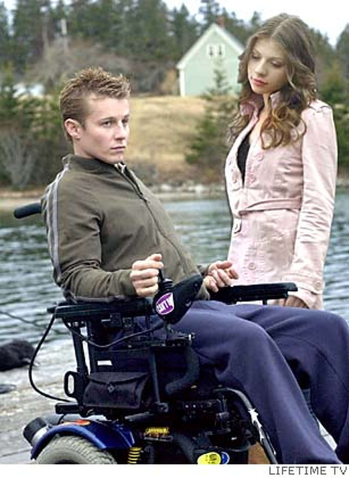 DIVE25_.JPG Michelle Trachtenberg (right) and Will Estes (left) star in The Dive From Clausens Pier, a film based on Ann Packers spellbinding novel about a young womans quest to find herself after her fianc is paralyzed in a diving accident. LIFETIME TV