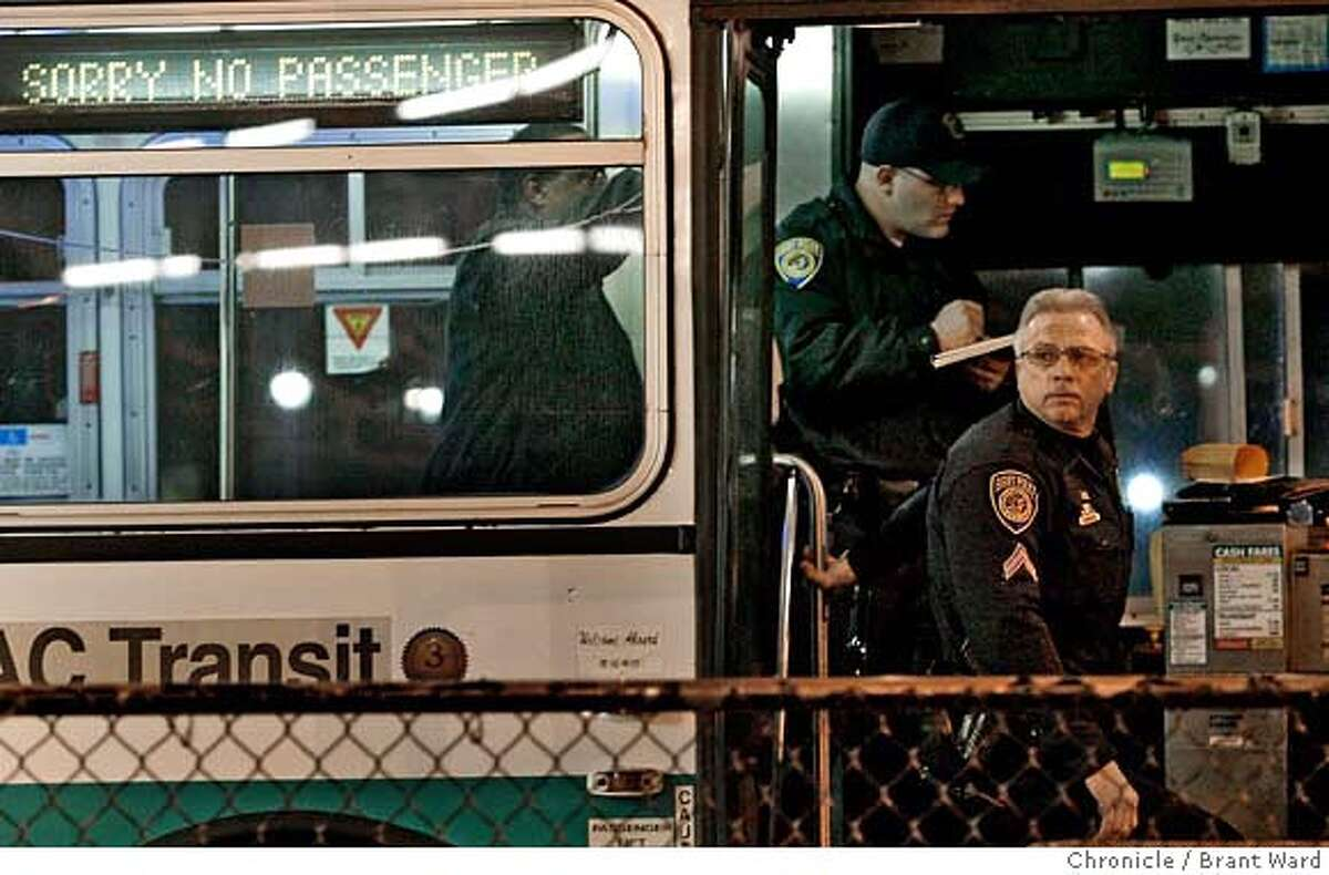 shooting120.JPG BART police used an out of service AC Transit bus to coordinate their investigaton. Hayward and BART police converged on the Hayward BART station after a shooting Monday night. Three people were taken to the hospital and one person was taken into custody. The shooting apparently took place outside the station in the bus area. {Brant Ward/San Francisco Chronicle}1/29/07