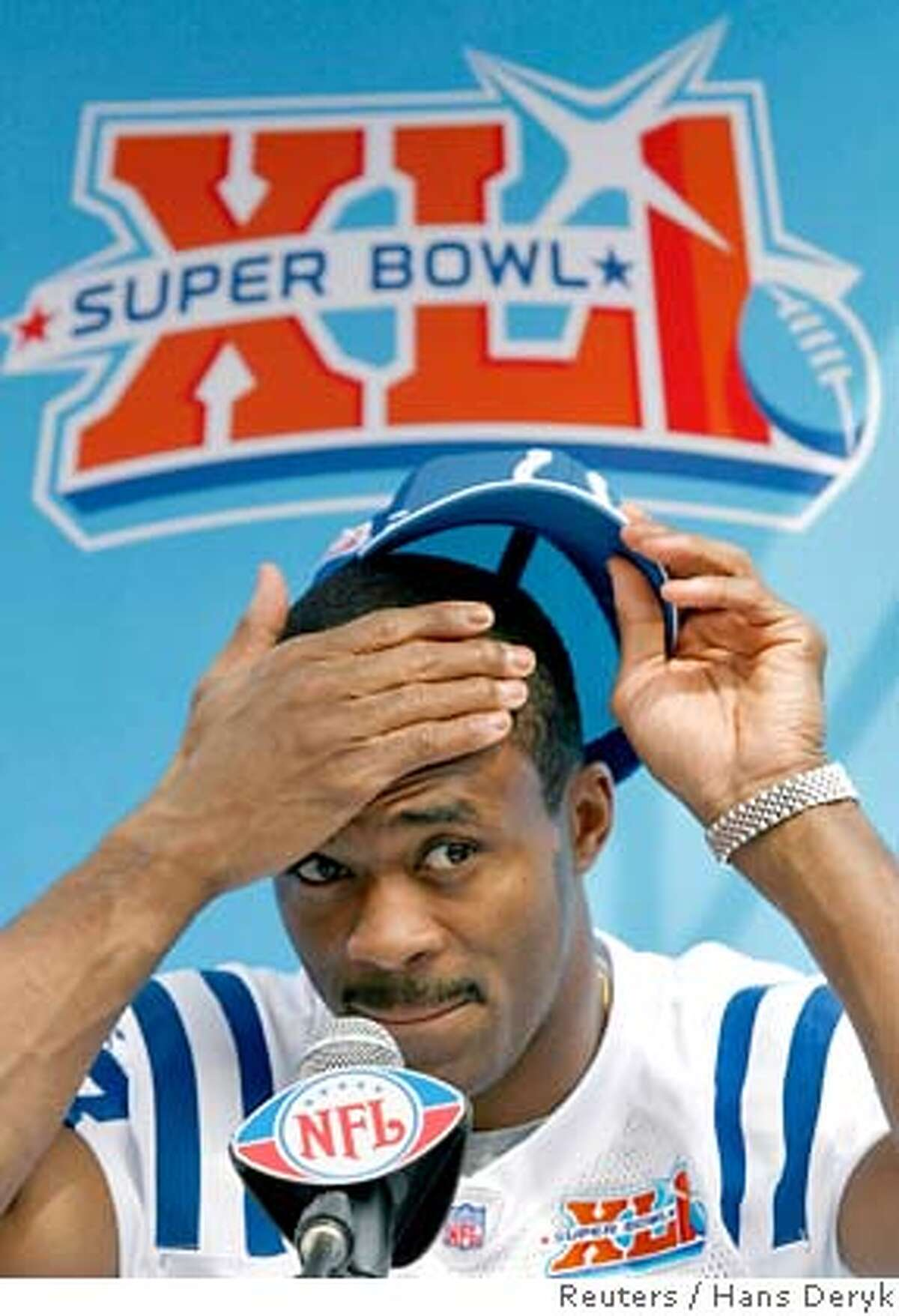 Indianapolis Colts receiver Marvin Harrison listens to a question during media day for the NFL's Super Bowl XLI football game in Miami January 30, 2007. The Colts will face the Chicago Bears in Super Bowl XLI on February 4. REUTERS/Hans Deryk (UNITED STATES)