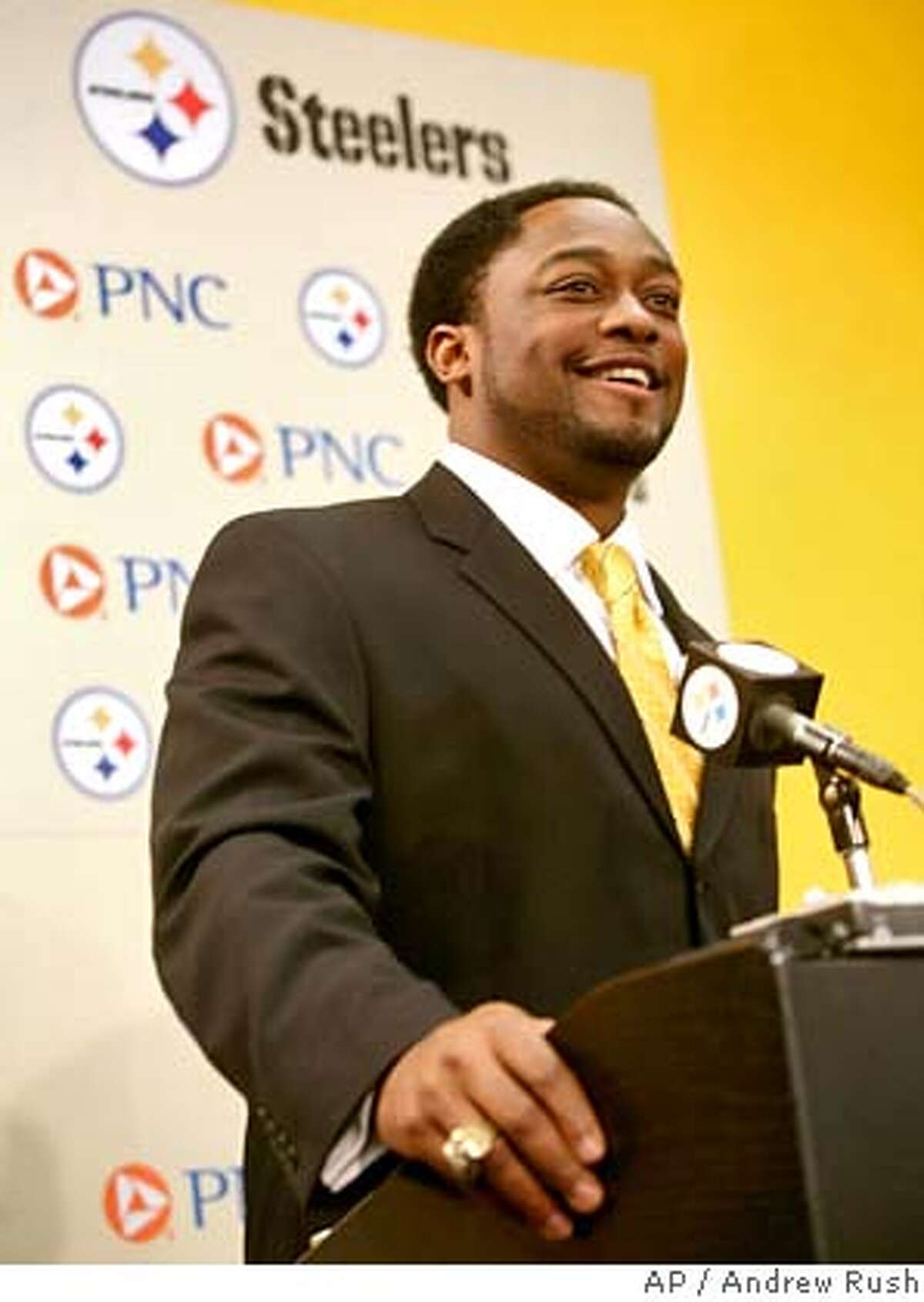 Mike Tomlin addresses the media the Pittsburgh Steelers headquarters in Pittsburgh, Monday, Jan. 22, 2007. Tomlin, the defensive coordinator of the Minnesota Vikings, was hired by the Steelers and will be the first black head coach in the team's 74-year history. (AP Photo/Andrew Rush) EFE OUT