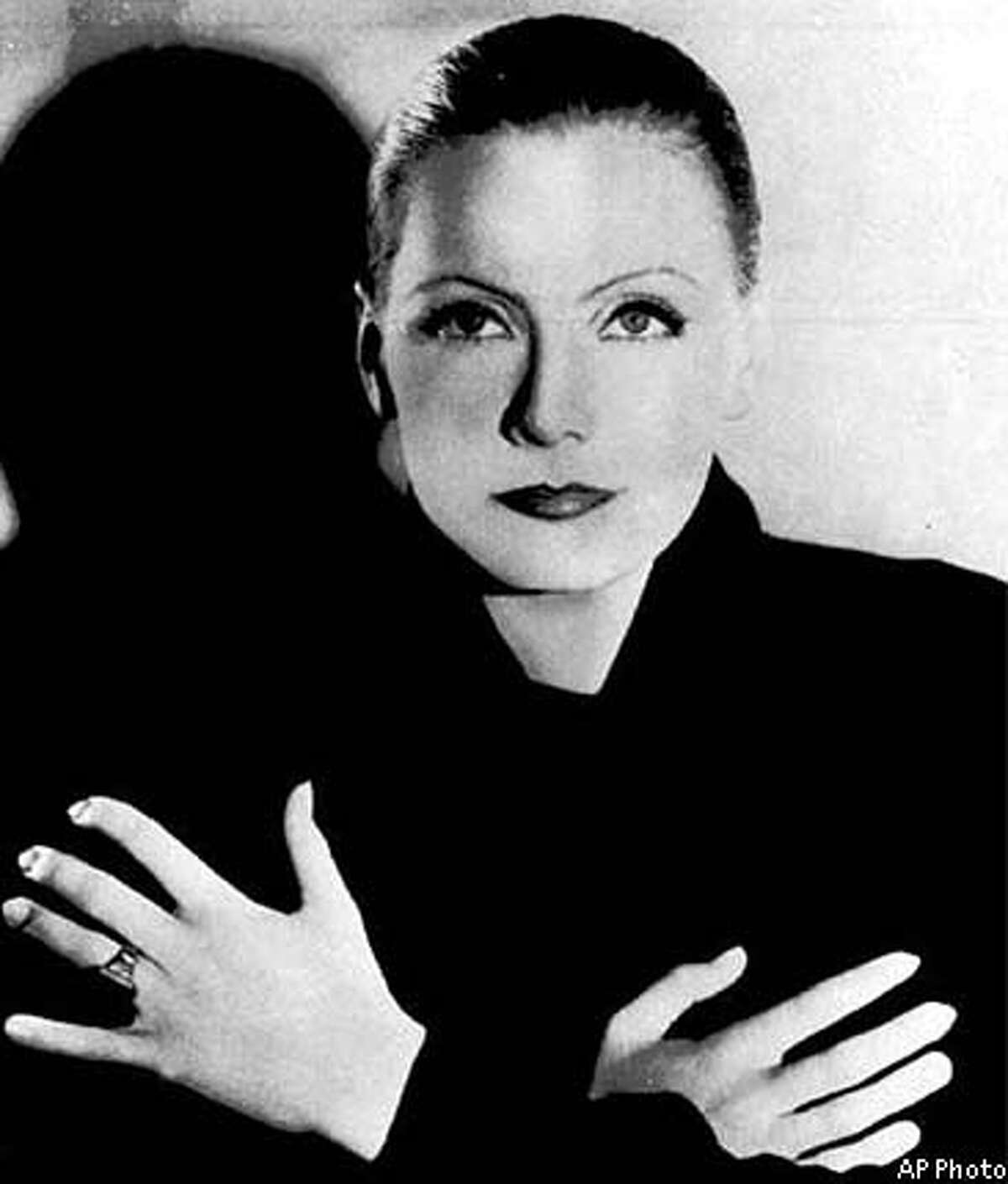 Shown are undated file photo,Greta Garbo. After years of a rumored love affair with Mercedes de Acosta letters from Garbo were displayed Monday, April 17, 2000, after being unsealed for the first time on Saturday, April 15, 2000 at the Rosenbach Museum and Library in Philadelphia. The 113 items that included letters, flower notes, telegrams, photos and poems chronicled a 28-year friendship of ups and downs, but gave no explicit evidence of a lesbian relationship between the two. (AP Photo/Acosta- Rosenbach Museum and Library, ho; Garbo- AP file photo)