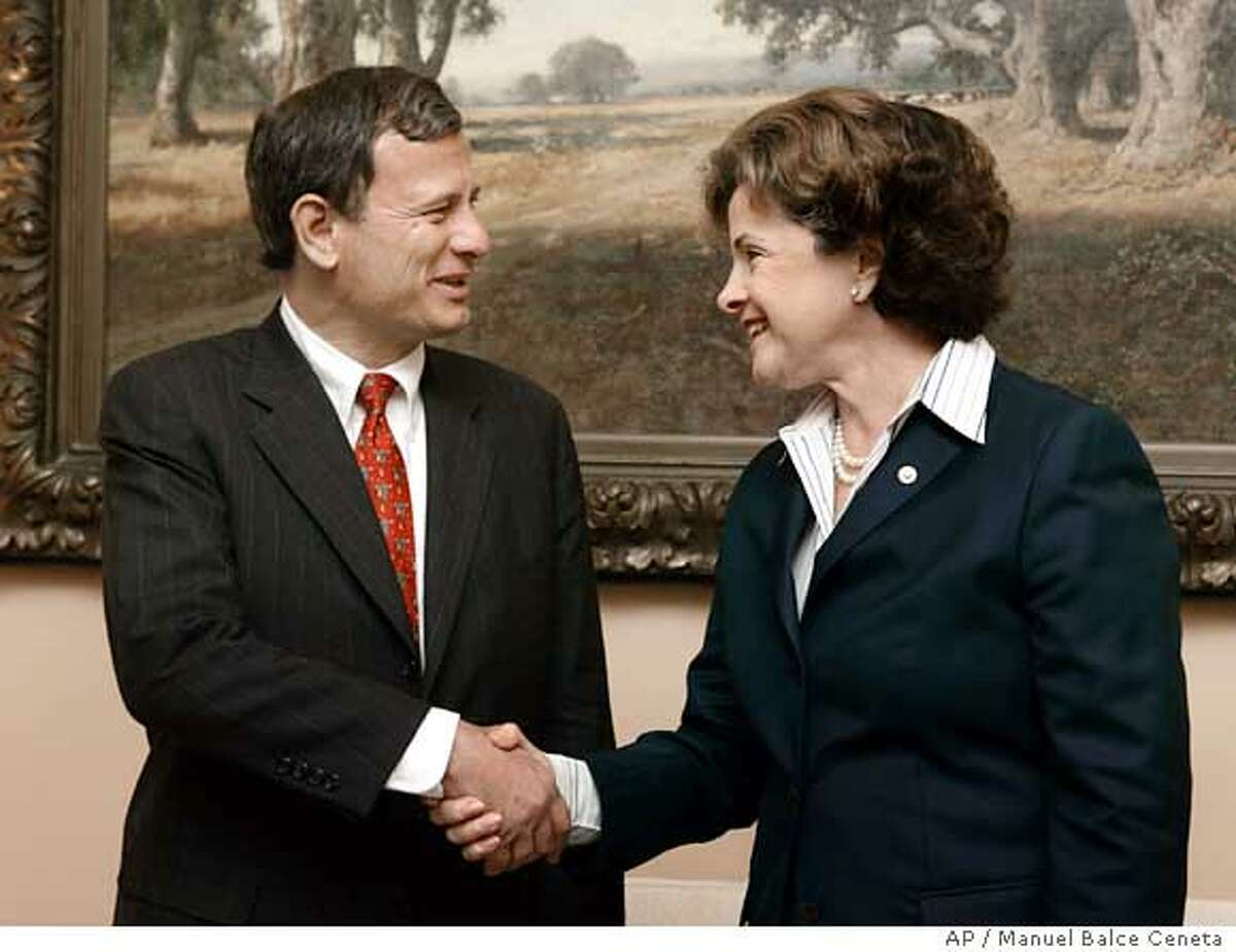 U.S. Supreme Court nominee John Roberts, left, meets with Sen. Dianne Feinstein, D-Calif., at her office on Capitol Hill, Monday, July 25, 2005, in Washington. (AP Photo/Manuel Balce Ceneta)
