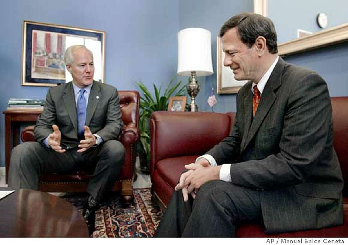 U.S. Supreme Court nominee John Roberts, right, meets with Sen. John Cornyn, R-Texas, in his office on Capitol Hill, Monday, July 25, 2005, in Washington. (AP Photo/Manuel Balce Ceneta)