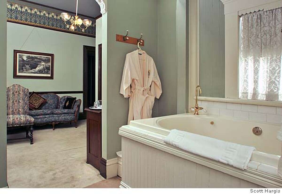 Room 24 at Inn San Francisco features a large walk-in jacuzzi area