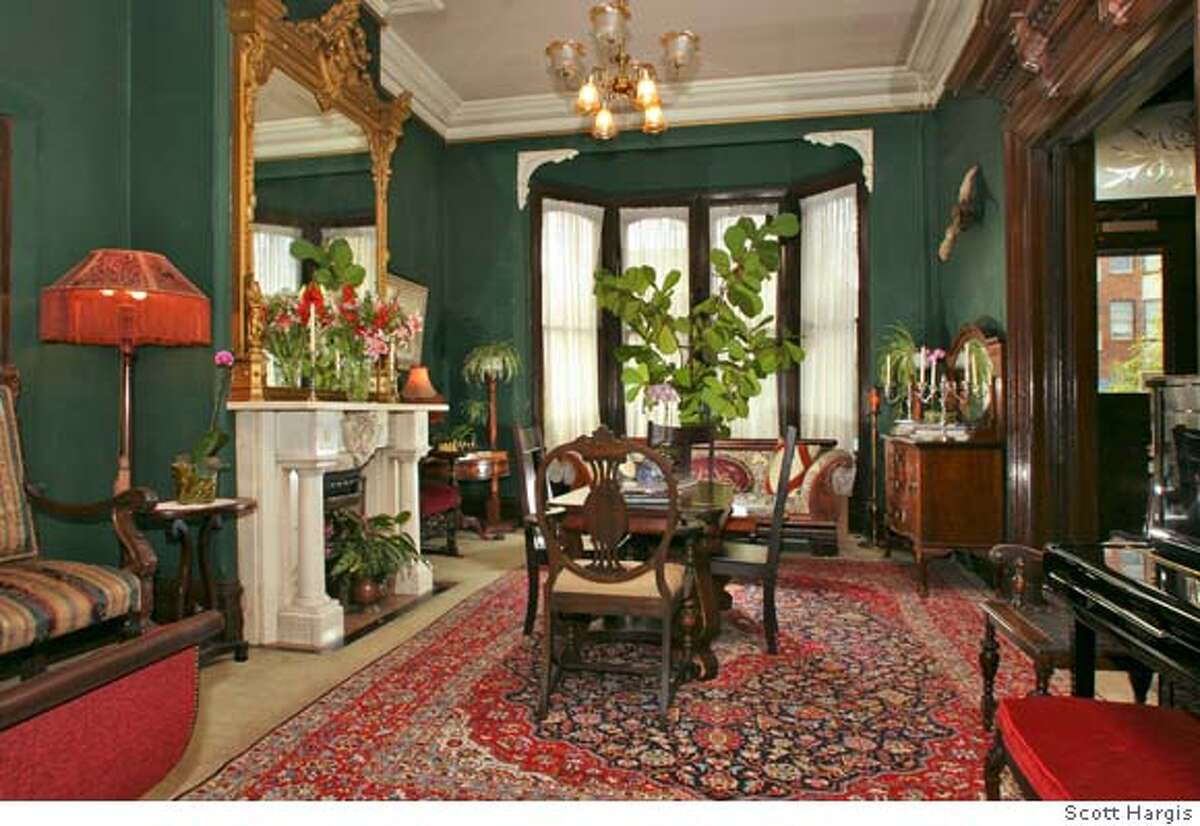 Parlor/living room of the Inn San Francisco has period furnishings and art.