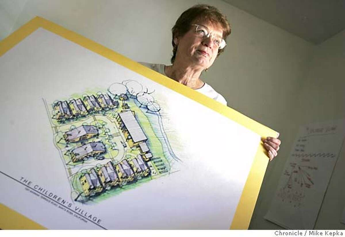 village25027_mk.JPG Lia Rowley director of of Children's village in Santa Rosa holds to the plans for the Santa Rosa facilty. 7/19/05 Mike Kepka / The Chronicle MANDATORY CREDIT FOR PHOTOG AND SF CHRONICLE/ -MAGS OUT