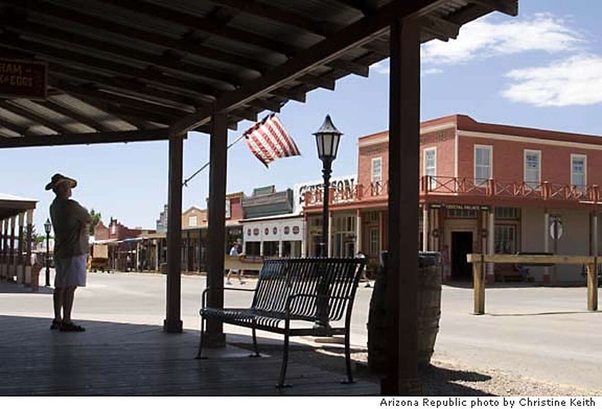 Charles Smith, of Hampton, Va. looks toward the two-story Crystal Palace Saloon on Allen Street in Tombstone, Ariz., Wednesday, June 29, 2005. The second story is not in compliance with historical code, threatening the town's National Historic Landmark status. (Arizona Republic photo by Christine Keith)