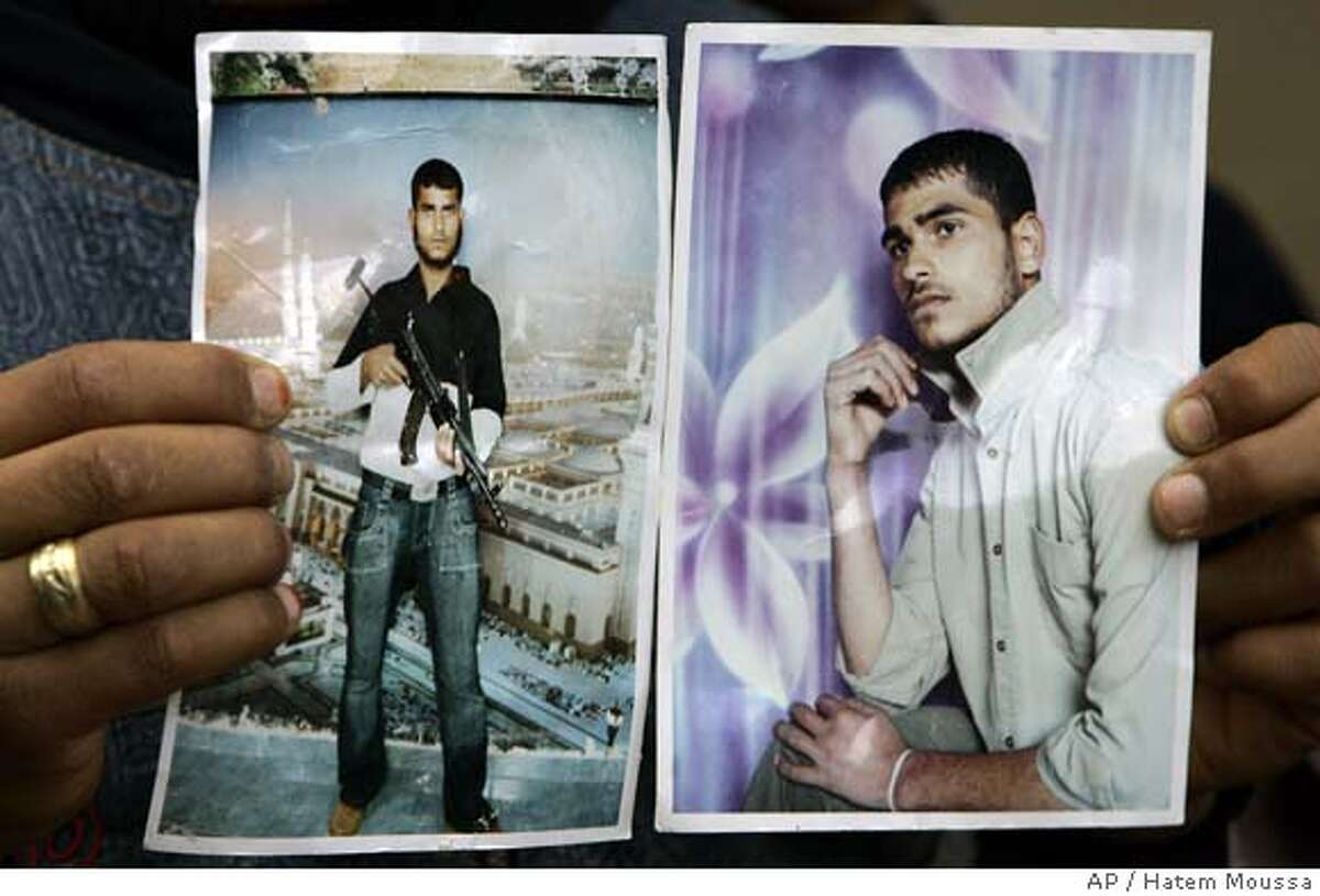 A relative holds photographs of Mohammed Saksak, 21, in the northern Gaza town of Beit Lahiya , Monday, Jan. 29, 2007. A Palestinian suicide bomber identified as Mohammed Saksak, 21, of Gaza City, attacked a bakery in Eilat on Monday, killing himself and three people, police said. It was the first suicide attack in Israel in nine months and the first ever to hit Eilat, Israel's southernmost city. (AP Photo/Hatem Moussa)
