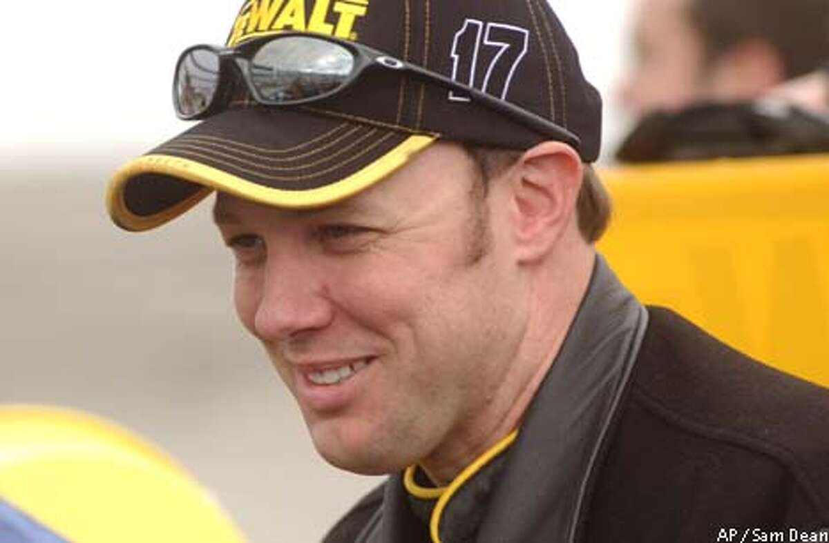 ** FOR USE WITH AUTO RACING PACKAGE ** Winston Cup driver Matt Kenseth smiles moments before the start of qualifying for the Virginia 500 in Martinsville, Virginia, Friday April 11, 2003 photo. (AP photo/ Sam Dean)