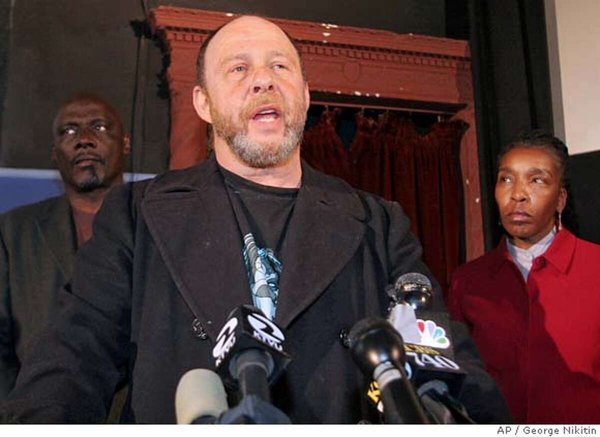 Defense attorney Stuart Hanlon, center, speaks at a news conference in front of legal investigative consultant, Wayne Thompson, left, and legal expert, Soffiyah Elijah, Sunday, Jan. 28, 2007 in San Francisco. Hanlon is the attorney for Herman Bell, one of eight men arrested Tuedsay, Jan. 23, 2007 in the 1971 killing of San Francisco Police Sgt. John Young. (AP Photo/George Nikitin)