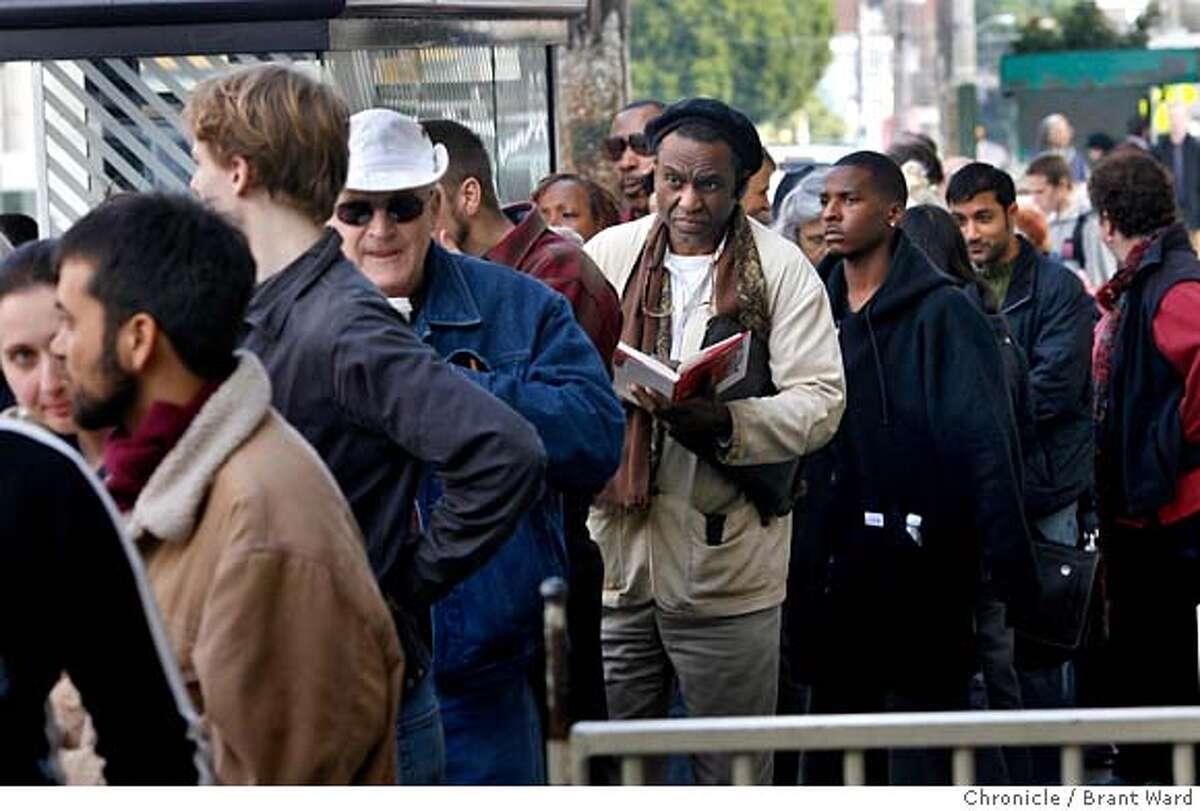 copkilled112.JPG A diverse crowd waited on 16th Street in the Mission district to get into the film