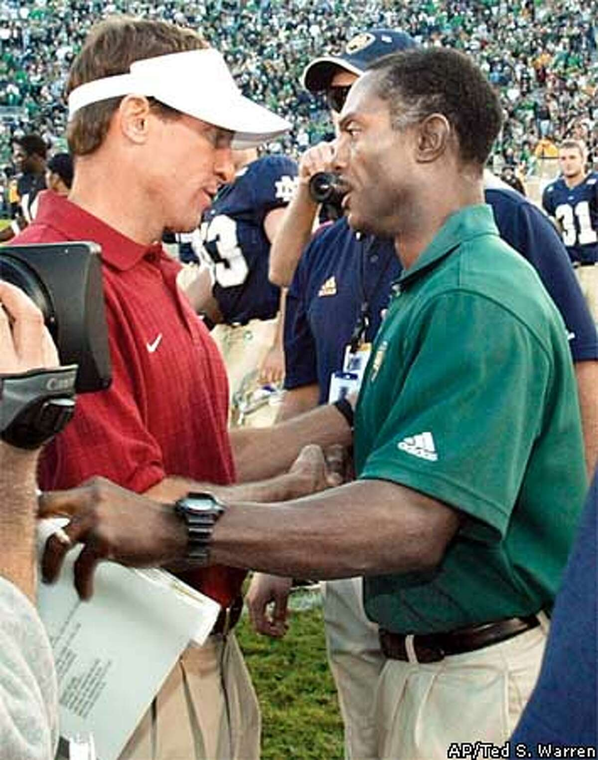 Notre Dame head coach Tyrone Willingham, right, greets Stanford head coach Buddy Teevens, left, after Notre Dame beat Stanford, 31-7, at Notre Dame Stadium, Saturday, Oct. 5, 2002, in South Bend, Ind. (AP Photo/Ted S. Warren) ALSO RAN 11/25/02