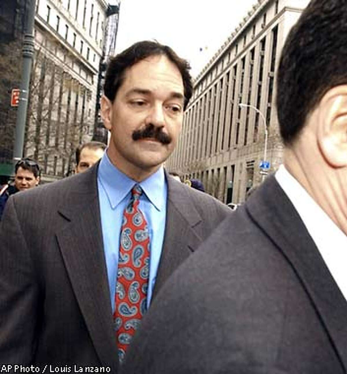 Frank Quattrone, a former investment banker with Credit Suisse First Boston, leaves Manhattan federal court in New York Wednesday, April 23, 2003. Quattrone was charged with obstructing investigations into CSFB's questionable initial public offering practices and conflicts of interest between stock research and banking. (AP Photo / Louis Lanzano)
