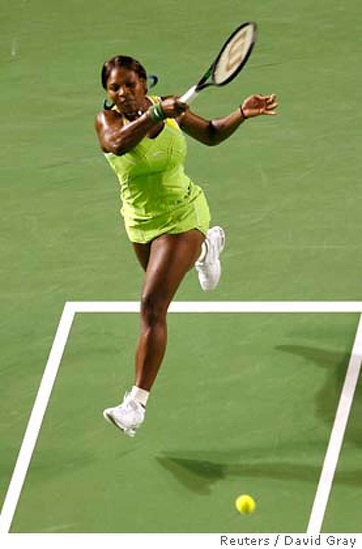 Serena Williams of the U.S. hits a shot during the women's final match against Russia's Maria Sharapova at the Australian Open tennis tournament in Melbourne January 27, 2007. REUTERS/David Gray (AUSTRALIA)