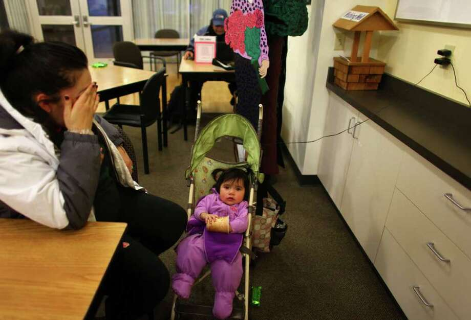 Fatima Lopez celebrates her first birthday by sitting in a warming shelter with her mother Elaine on Friday, January 20, 2012 in Auburn. An ice storm wreaked havoc in the area, bringing down trees and power lines. Power was out in large parts of the area, including at the Lopez home. Photo: JOSHUA TRUJILLO / SEATTLEPI.COM