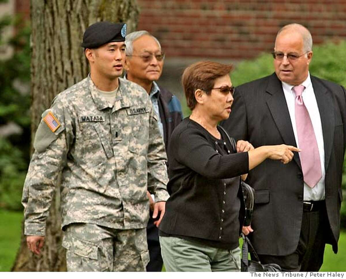 ** CORRECTS NAME OF WOMAN AND RELATIONSHIP ** Army Lt. Ehren Watada, left, walks with father, Bob Watada; his stepmother, Rosa Sakanishi; and attorney, Eric Seitz, during a lunch break in an Army hearing concerning Watada's refusal to deploy to Iraq, at Fort Lewis, Wash., Thursday, Aug. 17, 2006. Watada, 28, of Honolulu, was charged last month with conduct unbecoming an officer, missing troop movement and contempt toward officials. He refused to deploy to Iraq on June 22 with his Stryker unit, the 3rd Brigade, 2nd Infantry Division based at Fort Lewis. (AP Photo/The News Tribune, Peter Haley) Ran on: 08-26-2006 Lt. Ehren Watada Ran on: 08-26-2006 Ran on: 08-29-2006 1st Lt. Ehren Watada says laws oblige him to refuse orders to fight what he believes is an illegal war. Ran on: 08-29-2006 1st Lt. Ehren Watada says laws oblige him to refuse orders to fight what he believes is an illegal war. Ran on: 09-02-2006 Conduct unbecoming: Army Lt. Ehren Watada (with father Bob Watada) says laws oblige him to refuse orders to fight what he believes is an illegal war. Ran on: 01-18-2007 1st Lt. Ehren Watada joined the Army in 2003 but refused to go to Iraq, saying the war is illegal. CORRECTS NAME OF WOMAN AND RELATIONSHIP