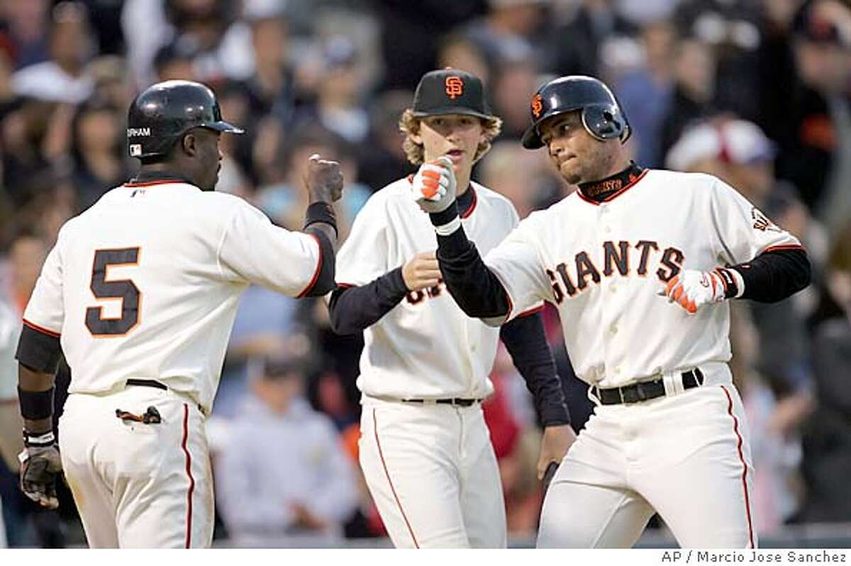 San Francisco Giants' Pedro Feliz, right, is greeted at the plate by teammate Ray Durham (5) after a two-run home run off Florida Marlins starter Dontrelle Willis in the third inning on Friday, July 22 2005 in San Francisco, Calif. (AP Photo/Marcio Jose Sanchez)