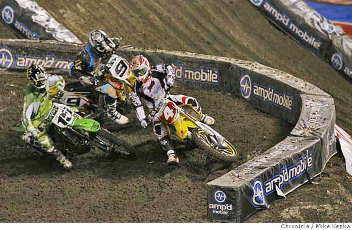 #4 Ricky Carmichael leads in the first corner of his qualifying round. Super cross comes the AT&T Stadium Saturday, 1/27/07. Mike Kepka / The Chronicle
