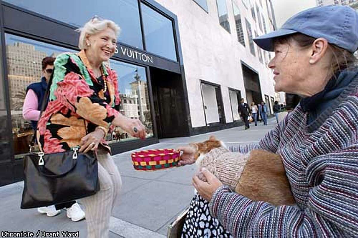 Renee and Wally have worked the Union Square corner of Geary and Stockton Streets in San Francisco for months...here a Russian tourist gives her a few coins in her easter basket. She says she would not mind a substitute for cash from tourists if it helped her and her cat get through the day. By Brant Ward/Chronicle
