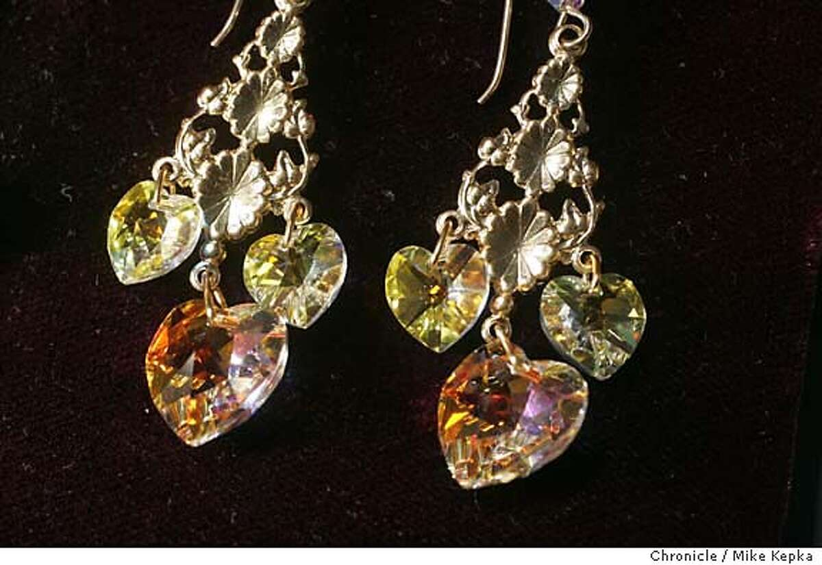 John Amman's Austrian crystal earrings. Vendor chic in from Civic Center to the Ferry Building. 6/30/05 Mike Kepka / The Chronicle