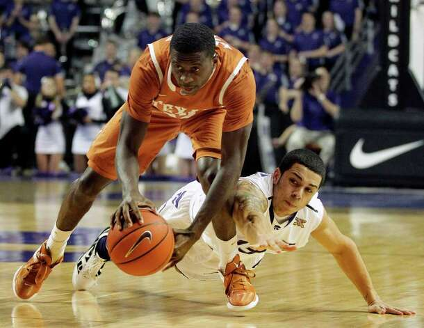 Kansas State guard Angel Rodriguez, right, tries to steal the ball from Texas guard Myck Kabongo (12) during the first half of an NCAA college basketball game on Wednesday, Jan. 18, 2012, in Manhattan, Kan. Photo: AP