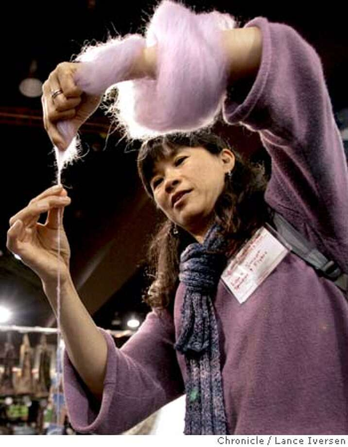 KNITTING_0056.jpg_  Laura Smoot from San Francisco and Spindlers & Flyers, Demonstrates how yarn was spun prior to the invention of the spinning wheel 1,000 years ago. With the exception of using a CD as a weight her method dates back 44,000 years. The Fiber Arts Market sponsored by Crochet Guild of America and The Knitting Guild Association is underway at the Oakland Marriott. By Lance Iversen/San Francisco Chronicle MANDATORY CREDIT PHOTOG AND SAN FRANCISCO CHRONICLE. Photo: Lance Iversen