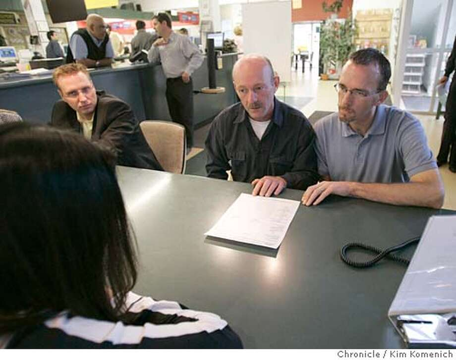 Calgary's gay community reacts to the Canadian government's decision to allow same-sex unions.  Canadian gay rights activist Keith Purdy and partner Rick Kennedy meet with Selena Tsu to make arrangements for their marriage license signing the following day (Friday 7/22/05.) PHOTO TAKEN 7/21/05  San Francisco Chronicle Photo by Kim Komenich Photo: Kim Komenich