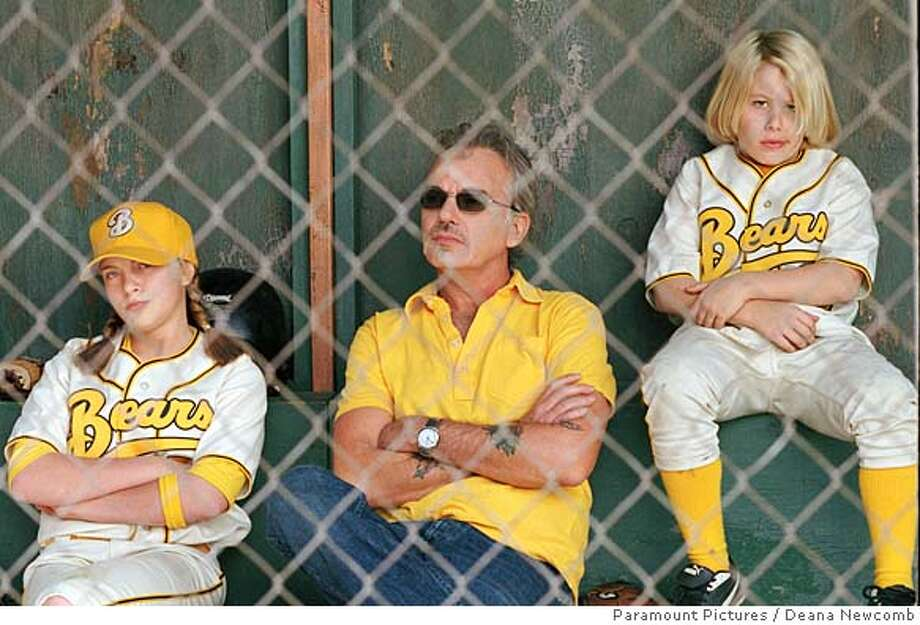 "In this photo provided by Paramount Pictures, grizzled former minor league baseball player and now Little League coach Morris Buttermaker (Billy Bob Thornton, center) takes in the action with two of his players, Amanda Whurlitzer (Sammi Kane Kraft, left) and Tanner Boyle (Timmy Deters, right) in ""Bad News Bears."" (AP Photo/Paramount Pictures/ Deana Newcomb) Photo: DEANA NEWCOMB"