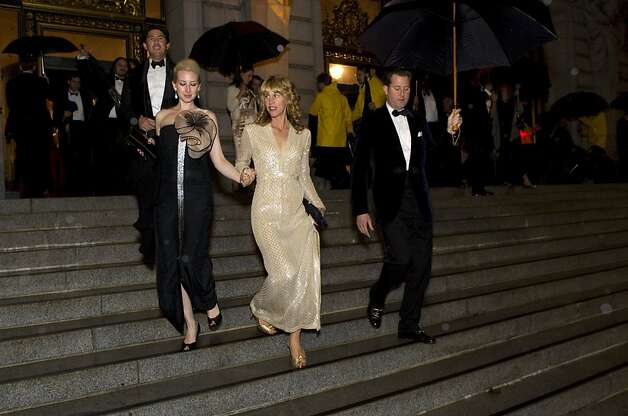 Lydia Bergman (left) and Melissa Barber walk down the stairs of City Hall on their way from dinner to the performance during the San Francisco Ballet Opening Night Gala in San Francisco, Calif., on Thursday, January 19, 2012. Photo: Laura Morton, Special To The Chronicle
