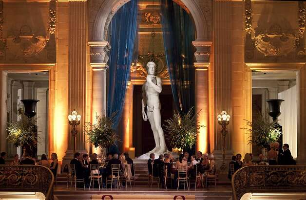 Guests of the the San Francisco Ballet Opening Night Gala sit down to dinner at City Hall in San Francisco, Calif., on Thursday, January 19, 2012.  The decor, designed by Riccardo Benavides, was inspired by the Italian Renaissance. Photo: Laura Morton, Special To The Chronicle