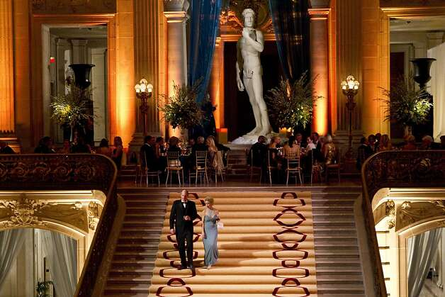 A couple walks down the stairs of City Hall during the San Francisco Ballet Opening Night Gala in San Francisco, Calif., on Thursday, January 19, 2012.   The decor for the gala, designed by Riccardo Benavides, was inspired by the Italian Renaissance. Photo: Laura Morton, Special To The Chronicle