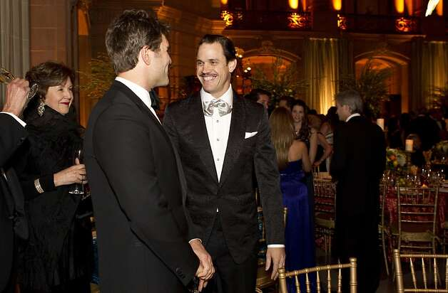 Zack Bogue (second from left) talks with Robert Mailer Anderson (center) during cocktail hour at the San Francisco Ballet Opening Night Gala in City Hall in San Francisco, Calif., on Thursday, January 19, 2012. Photo: Laura Morton, Special To The Chronicle