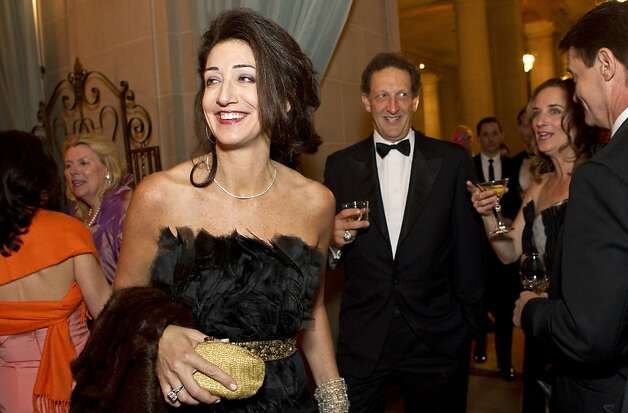 Pam Baer (left) and Larry Baer walk into the cocktail hour while attending the the San Francisco Ballet Opening Night Gala at City Hall in San Francisco, Calif., on Thursday, January 19, 2012. Photo: Laura Morton, Special To The Chronicle