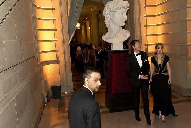 Alex Chases and Erin Glenn (right) walk through City Hall during the San Francisco Ballet Opening Night Gala in San Francisco, Calif., on Thursday, January 19, 2012.  The decor was inspired by the Italian Renaissance. Photo: Laura Morton, Special To The Chronicle