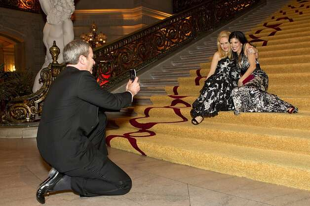 Marie Ralph and Aimee West (right) have their photo taken on the steps of City Hall during the San Francisco Ballet Opening Night Gala in San Francisco, Calif., on Thursday, January 19, 2012. Photo: Laura Morton, Special To The Chronicle