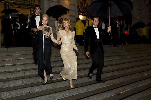 Lydia Bergman, Melissa Barber and Patrick Barber (left to right) walk down the stairs of City Hall on their way from dinner to the performance during the San Francisco Ballet Opening Night Gala in San Francisco, Calif., on Thursday, January 19, 2012. Photo: Laura Morton, Special To The Chronicle