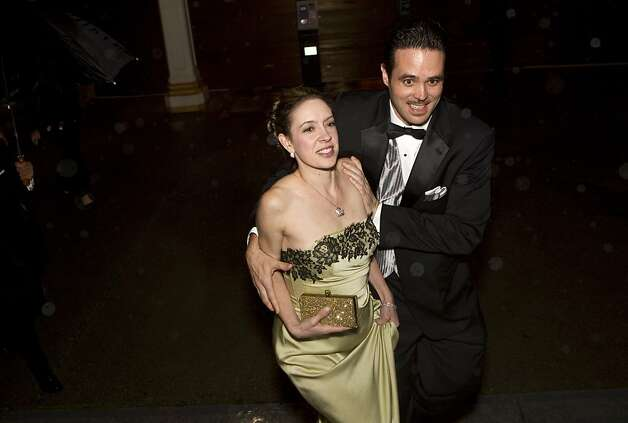 Colman O'Leary (right) tries to help Tessa O'Leary keep warm while walking to the performance in a rainstorm during the San Francisco Ballet Opening Night Gala in San Francisco, Calif., on Thursday, January 19, 2012. Photo: Laura Morton, Special To The Chronicle