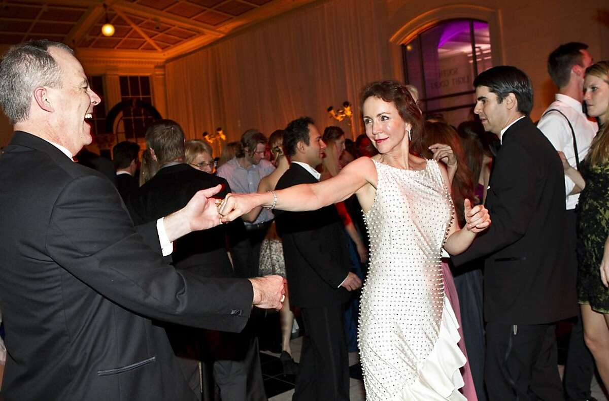 Alex Mayer and Suzanne Muntzing dance with each other during the after party for the San Francisco Ballet Opening Night Gala at City Hall in San Francisco, Calif., on Thursday, January 19, 2011.
