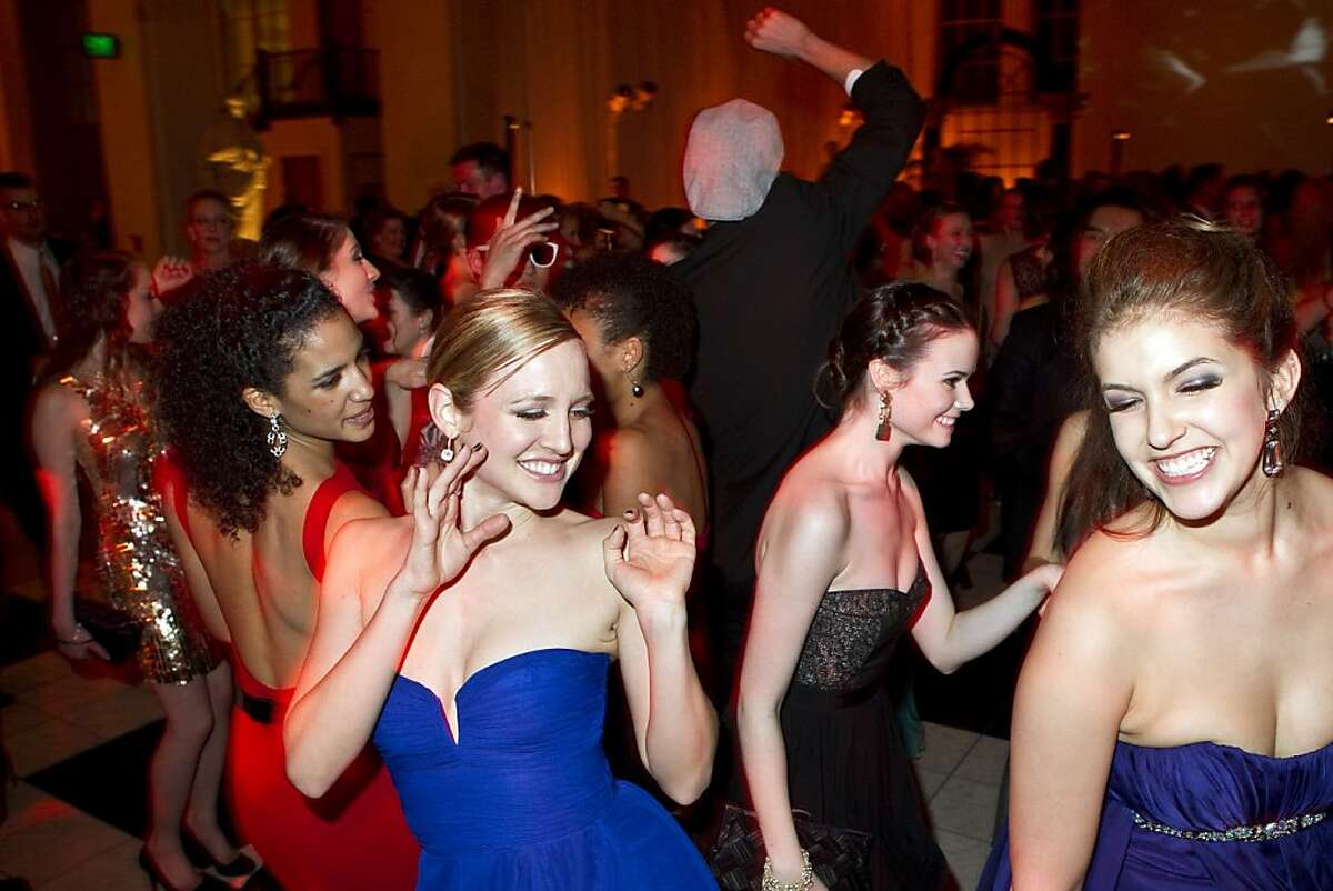 Alexandra Meyer Lory dances with Lauren Hawkins (right) during the post-performance party for the San Francisco Ballet Opening Night Gala at City Hall in San Francisco, Calif., on Thursday, January 19, 2011.