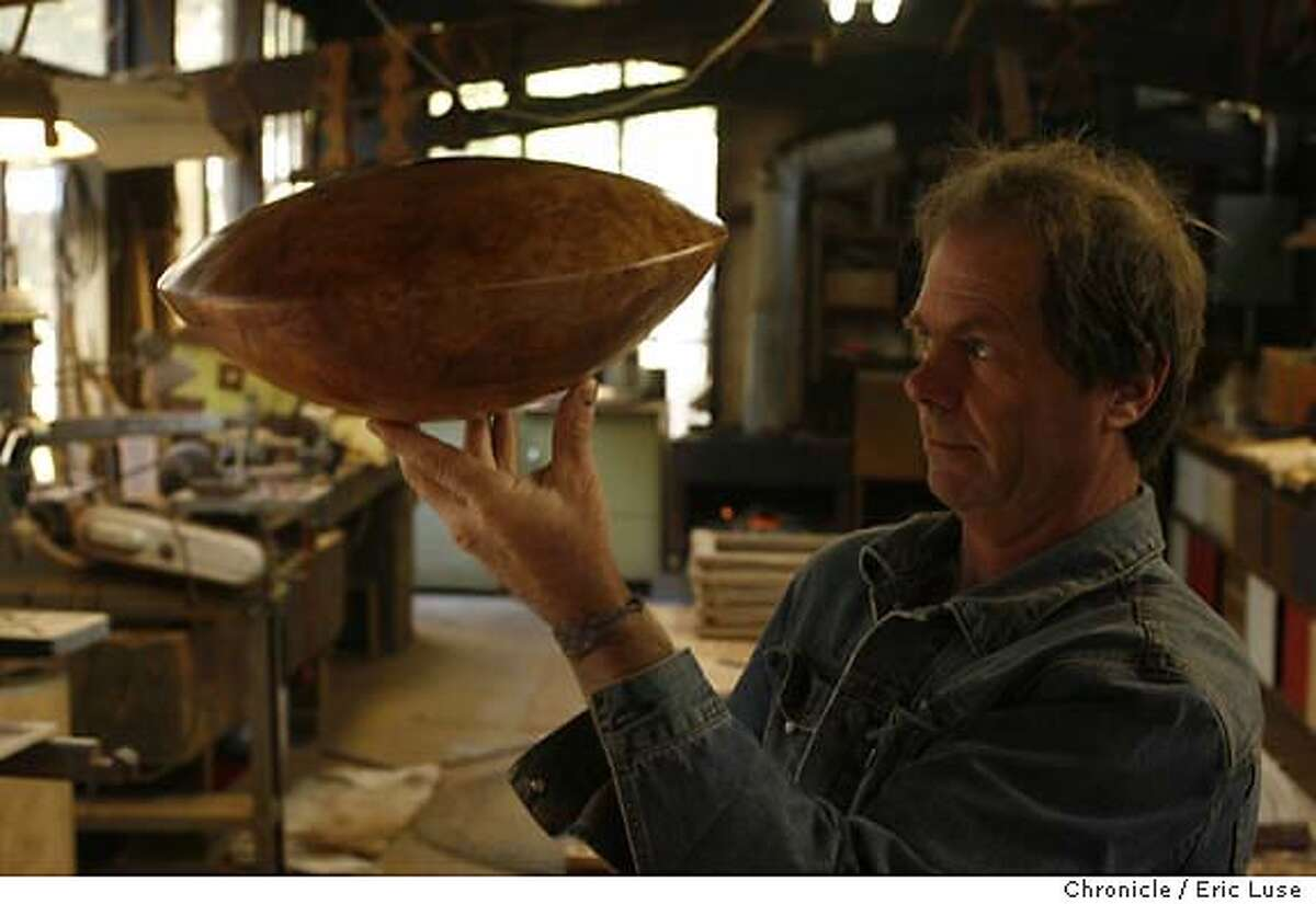 bolinas_1178_el.JPG Tripp with one his Ornamental's, A Hollow Vessel made from Big Leaf Maple which he says is very exciting to pull off because they can explode on you at anytime. Tripp Carpenter in his Bolinas workshop that once was his father's. Bolinas and it's present personality Photographer: Eric Luse / The Chronicle names cq from source MANDATORY CREDIT FOR PHOTOG AND SF CHRONICLE/ -MAGS OUT