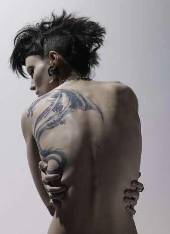 Actress Rooney Mara shows off  her character Lisbeth Salander's famous ink in The Girl With the Dragon Tattoo. Photo: Jean-Baptiste Mondino / © 2011 Columbia TriStar Marketing Group, Inc. All Rights Reserved.