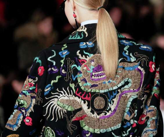 Ralph Lauren showed an embroidered dragon jacket in his fall  collection. Photo: Bebeto Matthews / AP