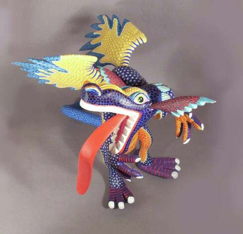 Oaxacan artist Elvis Castillo's  dragon sells for $215 at Los Manos Magicas. Photo: Los Manos Magicas