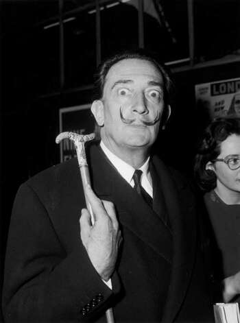 6th May 1959:  Salvador Dali (1904 - 1989), Spanish artist, arriving at Victoria from Paris to attend a party given by the publishers of the book 'The Case of Salvador Dali'.  (Photo by Reg Birkett/Keystone/Getty Images) Photo: Reg Burkett / Hulton Archive