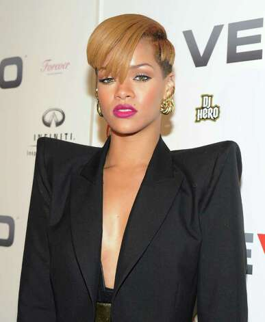 NEW YORK - DECEMBER 08:  Singer Rihanna attends the launch of EVO, a music-video website, at Skylight Studio on December 8, 2009 in New York City.  (Photo by Jason Kempin/Getty Images) Photo: Jason Kempin / San Antonio Express-News